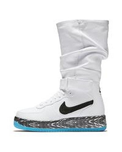white nike boots